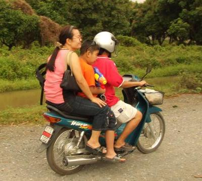 In Thailand, a whole family will share a scooter