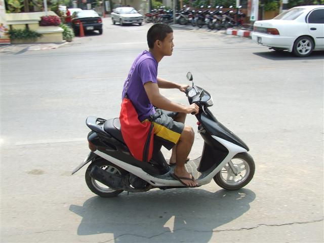 Small Engine Scooters : Motor scooters and potholes