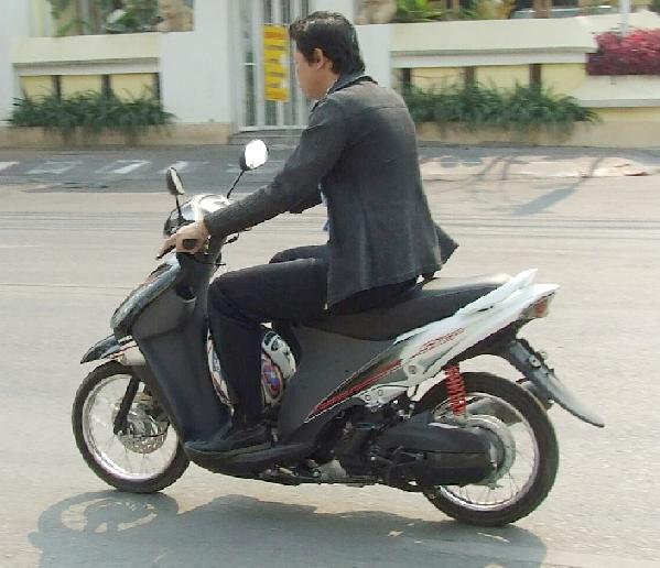 Where scooters dominate, scooting in a suit is perfectly suitable.